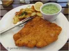 plate with schnitzel and potatoes