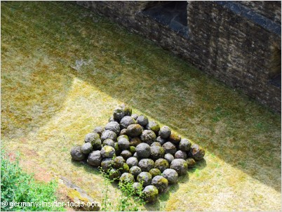 with these stone balls the castle once was attacked