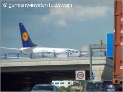 airplane crossing the motorway