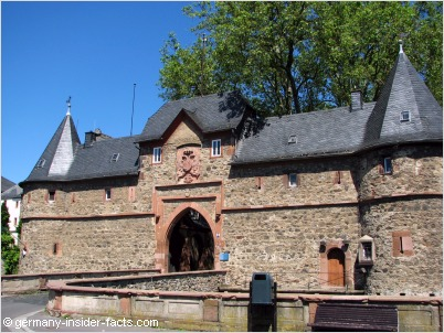 castle gate with coat of arms