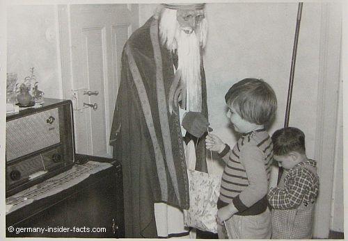 saint nicholas with two children