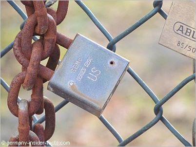 lock and chains at a fence