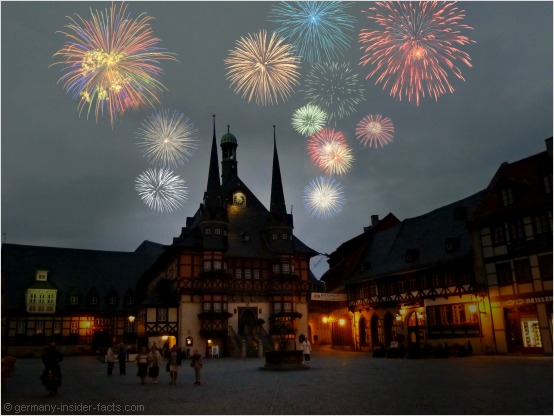 fireworks over a historic house