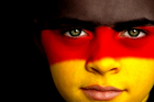 soccer fan with german flag painted on his face