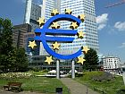 euro sign in front of a highrise