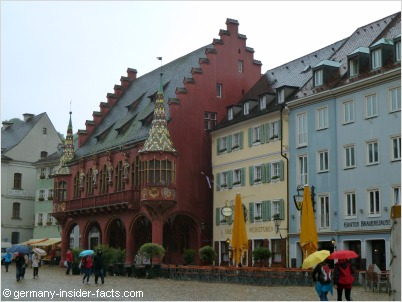 colourful merchants hall and munsterplatz in freiburg