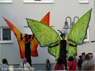 stilt walker with butterfly costume