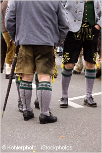 people wearing lederhosen