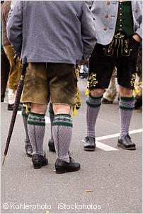 people wearing lederhosen